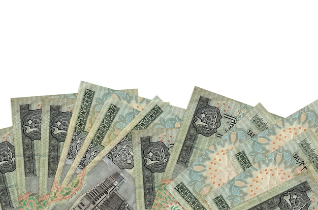20 egyptian pounds bills lies on bottom side of screen isolated on white wall with copy space.