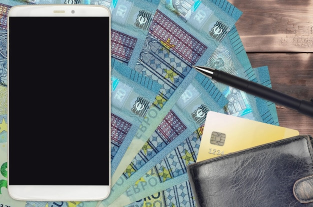 20ユーロ紙幣と財布とクレジットカード付きのスマートフォン