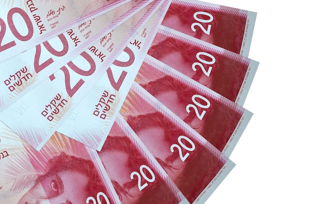 20 israeli new shekels bills lies isolated on white background with copy space stacked in fan shape close up