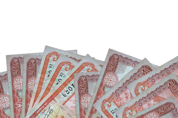 20 nepalese rupees bills lies on bottom side of screen isolated on white wall with copy space.