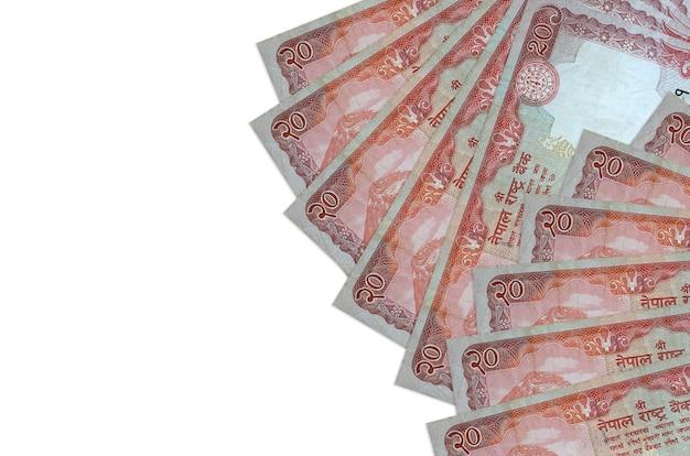 20ネパールルピーの請求書は、コピースペースのある白い壁に隔離されています。 。大量の自国通貨資産