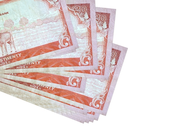 20 nepalese rupees bills lies in small bunch or pack isolated on white. . business and currency exchange concept
