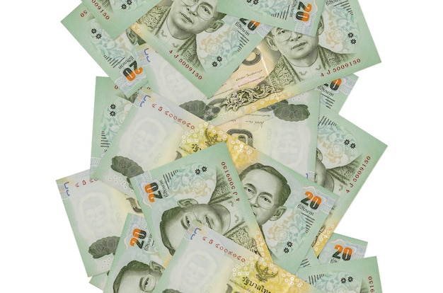 20 태국 바트 지폐에 고립 된 흰색 아래로 비행. 왼쪽과 오른쪽에 흰색 복사 공간이 떨어지는 많은 지폐