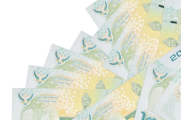 20 thai baht bills lies in different order isolated on white. local banking or money making concept.