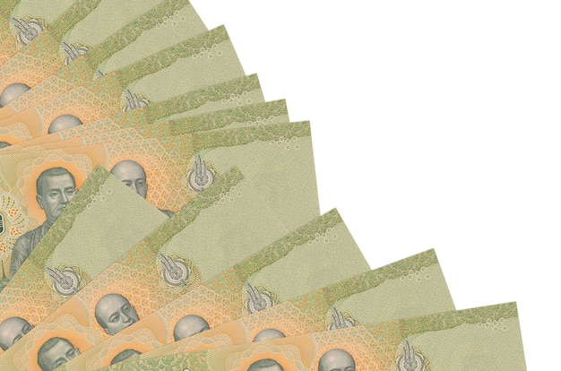 20 thai baht bills lies isolated on white background with copy space stacked in fan close up