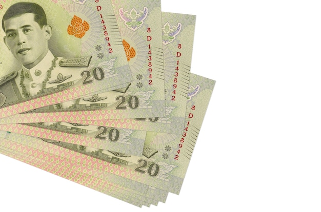 20 thai baht bills lies in small bunch or pack isolated on white.  business and currency exchange concept
