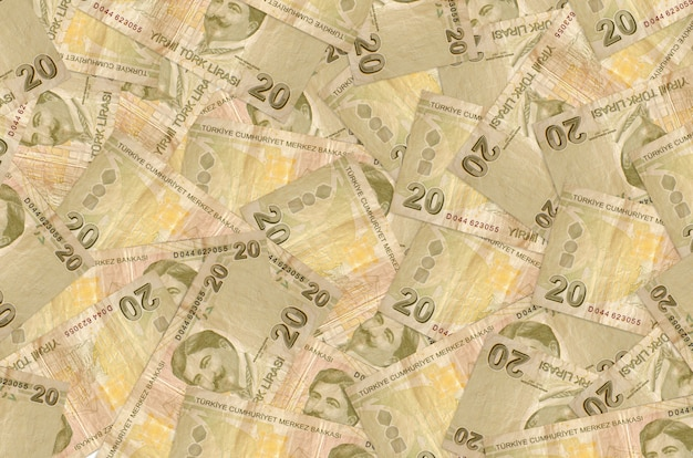 20 turkish liras bills lies in big pile. rich life conceptual wall. big amount of money