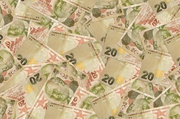 20 turkish liras bills lies in big pile