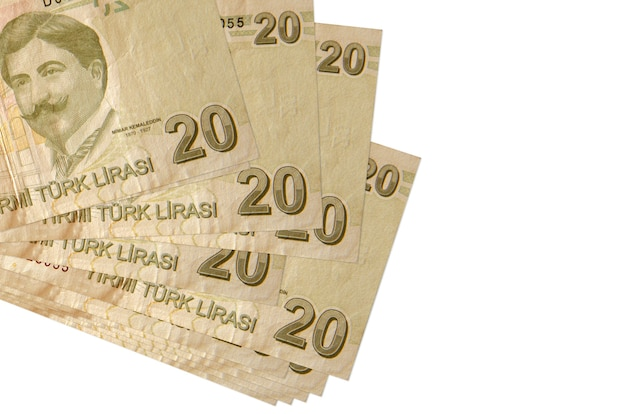 20 turkish liras bills lies in small bunch or pack isolated on white.  business and currency exchange concept
