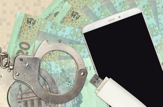 20ウクライナグリブナ紙幣と警察の手錠付きスマートフォン