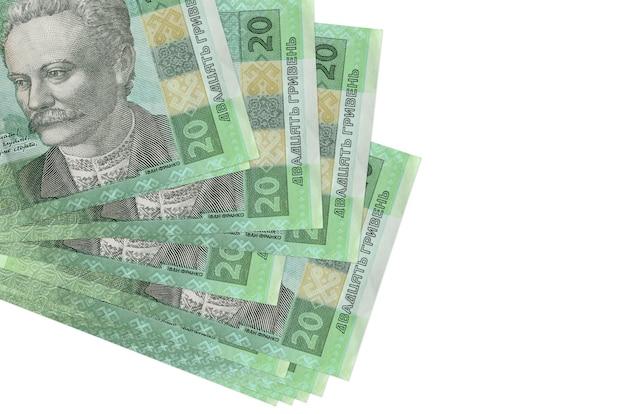 20ウクライナグリブナの請求書は、白で隔離された小さな束またはパックにあります。 。ビジネスと外貨両替の概念