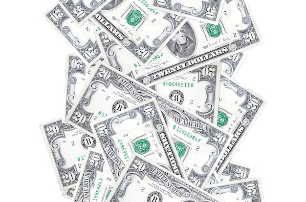 20 us dollars bills flying down isolated on white. many banknotes falling with white copy space on left and right side