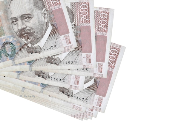 200 croatian kuna bills lies in small bunch or pack isolated on white.  business and currency exchange concept