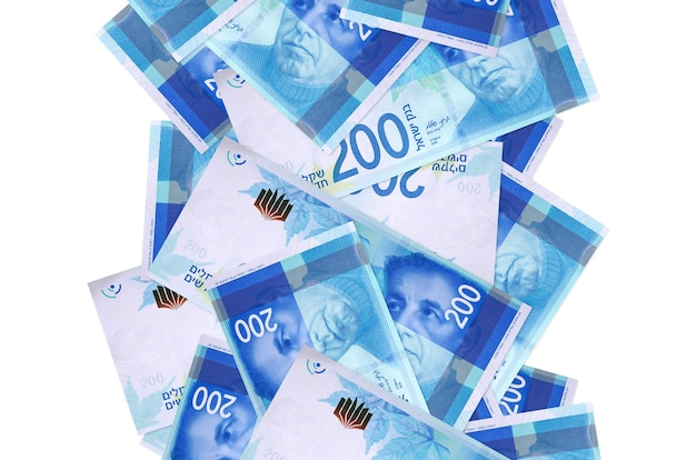 200 israeli new shekels bills flying down isolated  . many banknotes falling with white copy space on left and right side