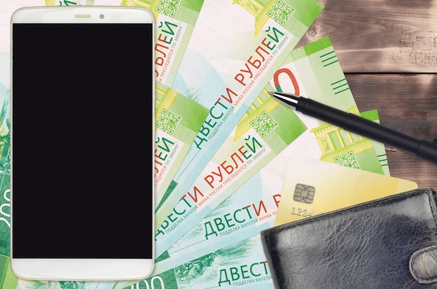 200 russian rubles bills and smartphone with purse and credit card