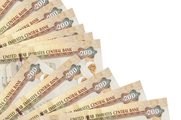 200 uae dirhams bills lies isolated on white background with copy space stacked in fan close up
