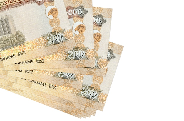200 uae dirhams bills lies in small bunch or pack isolated on white