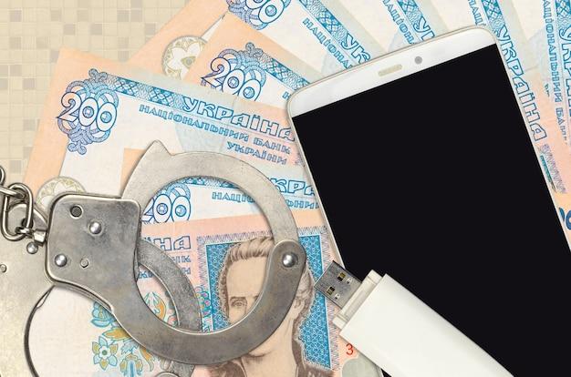 200ウクライナグリブナ紙幣と警察の手錠付きスマートフォン