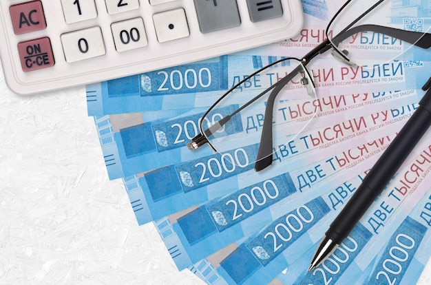 2000 russian rubles bills fan and calculator with glasses and pen