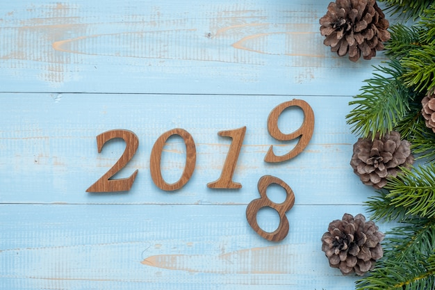 2018 - 2019 number with christmas decorations on wooden background