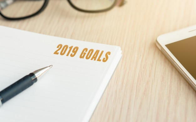 2019 goals word on life improvement book for new years resolution concept