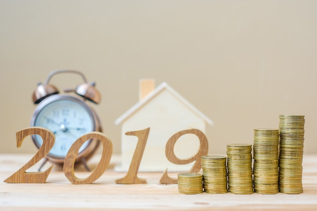 2019 happy new year with gold coins stack and wooden number