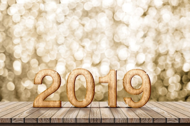 2019 happy new year wood on wood table with sparkling gold bokeh wall
