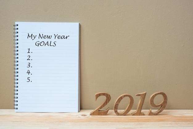 """2019 happy new years with notebook """" my new year goals """" text"""