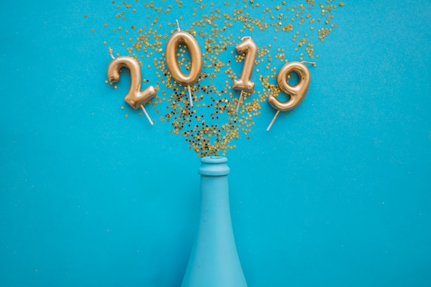 2019 inscription from candles with bottle