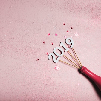2019 inscription on sticks in pink bottle