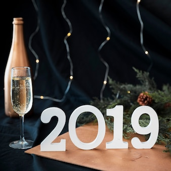 2019 inscription with champagne glass on table