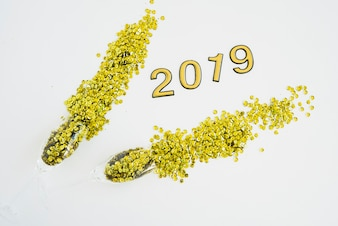 2019 inscription with scattered spangles on table