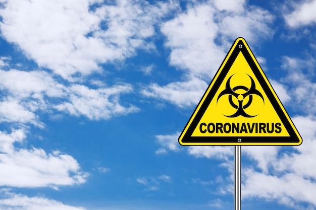 2019-ncov coronavirus danger area yellow biohazard road sign on a blue sky background. 3d rendering