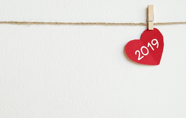 2019 new year greeting card template, red fabric heart with 2019 word with copy space