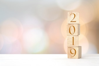 2019 new year greeting card, wooden cubes with 2019 on wood table