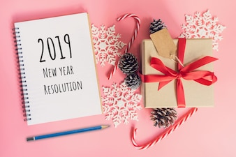 2019 New Year Resolution, top view brown gift box, notebook and christmas decoration