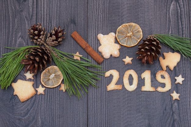 2019 numbers from cookies or biscuits on the wooden  background. new year 2019. top view.