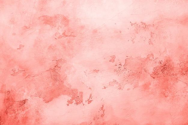 Абстрактный фон бетон цемента. грандж текстуры, обои. живой коралловый цвет года 2019. вид сверху, копия пространства.