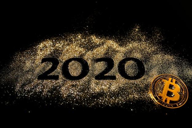 明けましておめでとう2020。数字の2と0のクリエイティブコラージュは、2020年を作りました。美しい輝く黄金の数字2020と黒のビットコイン