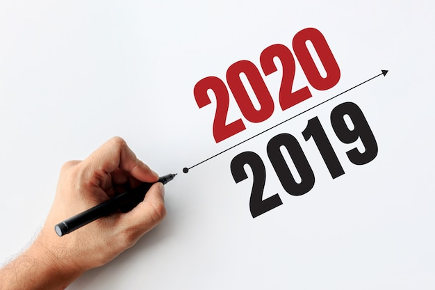 2020 and 2019 business concept. businessman writing a business plan
