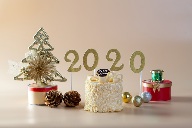 2020 gold and christmas decorations on orange background