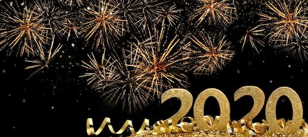 2020 golden figures standing in firework in the night