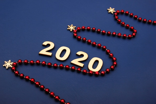 2020, happy new year. christmas decoration beads and christmas tree. idea of merry new year 2020 holiday.