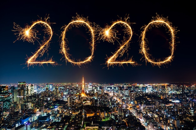2020 happy new year fireworks over tokyo cityscape at night, japan