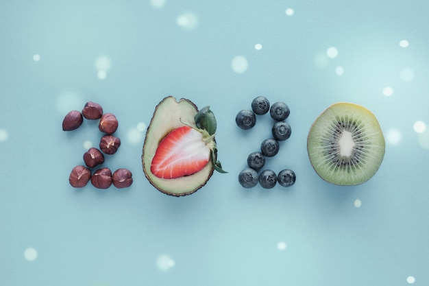 2020 made from healthy food on pastel blue background