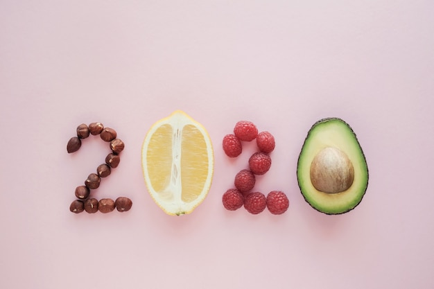 2020 made from healthy food on pastel pink  background