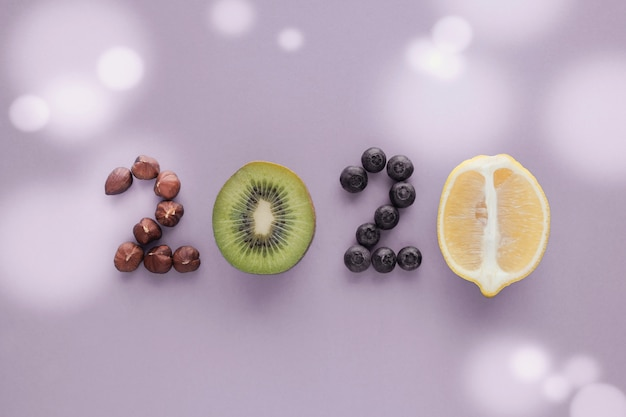 2020 made from healthy food on pastel  purple background