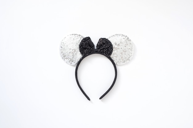 2020 mouse concept. isolated silver mouse ears headband with black bow. happy new year