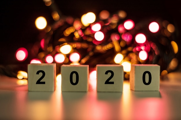 2020 new year wood stick on red bokeh