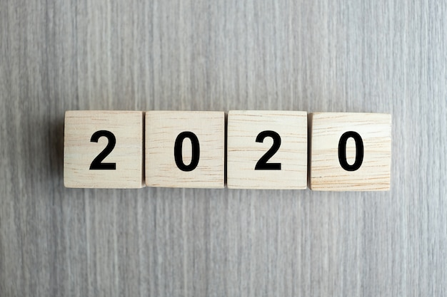 2020 new year wooden cubes on table background